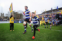 Luke Charteris of Bath Rugby, mascot in hand, runs out onto the field. Aviva Premiership match, between Bath Rugby and Saracens on December 3, 2016 at the Recreation Ground in Bath, England. Photo by: Patrick Khachfe / Onside Images