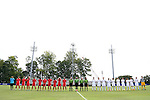 30 August 2015: The starters for Saint Mary's (left) and Elon (right) stand with the referees for the national anthem. The Elon University Phoenix played the Saint Mary's College Gaels at Koskinen Stadium in Durham, NC in a 2015 NCAA Division I Men's Soccer match. Elon won the game 1-0.