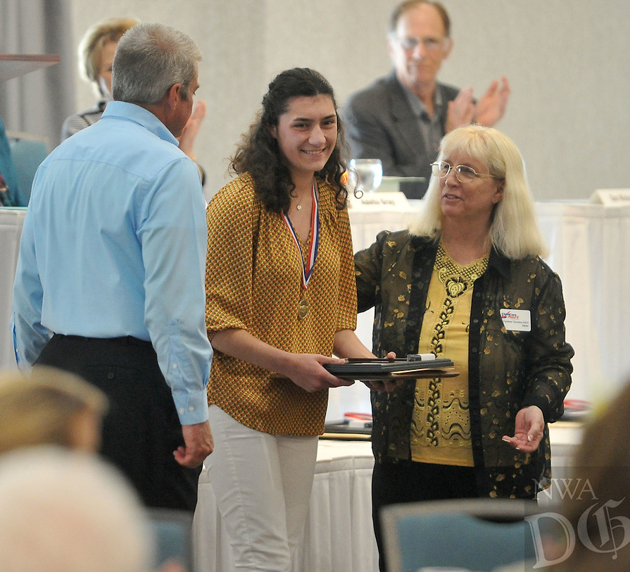 """NWA Democrat-Gazette/Michael Woods --04/22/2015--w@NWAMICHAELW... Woodland Junior High School student Olivia Bartz smiles as she receives her award during the 29th Annual """"Good Hearts"""" Youth eExcellence Awards presented by the Fayetteville Sequoyah Kiwanis Wednesday afternoon at the Hilton Garden Inn in Fayetteville."""
