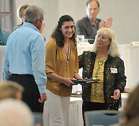 "NWA Democrat-Gazette/Michael Woods --04/22/2015--w@NWAMICHAELW... Woodland Junior High School student Olivia Bartz smiles as she receives her award during the 29th Annual ""Good Hearts"" Youth eExcellence Awards presented by the Fayetteville Sequoyah Kiwanis Wednesday afternoon at the Hilton Garden Inn in Fayetteville."