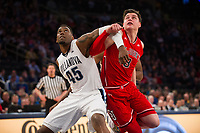NEW YORK, NY - Thursday March 9, 2017: Darryl Reynolds (#45) of Villanova and Amar Alibegovic (#3) of St. John's jockey for position as the two schools square off in the Quarterfinals of the Big East Tournament at Madison Square Garden.
