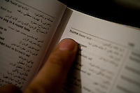 Shanaz, a failed asylum seeker from Iran, points to the word 'home' in her Engish-Persian dictionary. Shanaz is one of an estimated 300,000 rejected asylum seekers living in the UK. .. .