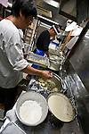 "Kitchen staff prepare dinner for guests aboard Kachidoki, a ""Yakata-bune"" pleasure boat run by Harumiya Co. in Tokyo, Japan on 31 August  2010. Photographer: Robert Gilhooly"