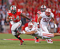 Ohio State Buckeyes running back Carlos Hyde (34) gets past Wisconsin Badgers linebacker Chris Borland (44) for a long gain in the first half  at Ohio Stadium on September 28, 2013.  (Chris Russell/Dispatch Photo)