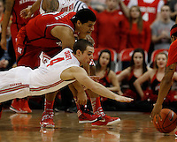 Ohio State Buckeyes guard Aaron Craft (4) dives for a loose ball against Nebraska Cornhusker Tai Webster in the second half at Value City Arena in Columbus Jan. 4, 2013 (Dispatch photo by Eric Albrecht)