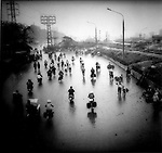 Bicycles in ?rain dust?, Hanoi, Vietnam.