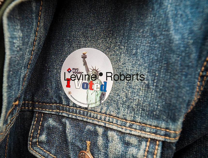"""A voter wears her """"I Voted"""" sticker on Election Day in New York on Tuesday, November 8, 2016. (© Richard B. Levine)"""