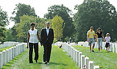 United States President Barack Obama and First Lady Michelle Obama hold hands as they visit Section 60 at Arlington National Cemetery, on Saturday, September 10, 2011, in Arlington, Virginia.  This section contains military personnel who were killed in the Iraq and Afghanistan wars since 9/11. .Credit: Leslie E. Kossoff / Pool via CNP