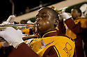 1 November 2007 - New Orleans, United States - The McDonogh 35 Roneagles Marching Band perform at an important football game in New Orleans. McDonogh No. 35 Senior High School was the first high school for African-American pupils in the city of New Orleans, Louisiana. Prior to 1917, during the era of segregated school systems in the Southern US, no public high school existed in New Orleans for African-American pupils. Those interested in pursuing an education beyond the eighth grade had to attend one of the city's three private secondary schools for blacks. It was in that year of 1917 that a group of spirited citizens met to petition the Orleans Parish School System to convert McDonogh 13 Boys' School from a white elementary school to a secondary educational facility for black pupils. The petition was granted and in the fall of 1917, McDonogh 35 became recognized as a four-year high school...MacDonogh No. 35 is also known for its marching band, a long cultural tradition in music rich New Orleans. The High school marching band plays at football games but also for cultural events, parades, and fierce yearly competitions between high schools. ..Like many high schools MacDonogh was destroyed by the hurricane Katrina and its students dispersed all around the country. New Orleans' high-stepping school bands fell silent. But the school was one of the first to re-open in 2006, and the band working with donated instruments started practise soon after. For many of the children playing music has been critical to their ability to return to normal life. Photo credit: Benedicte Desrus