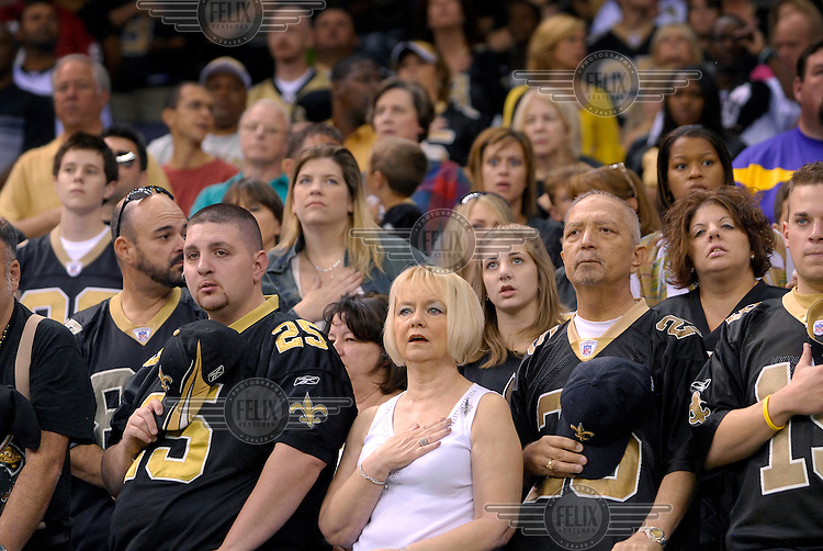 New Orleans Saints fans sing the national anthem before the start of the American Football match against the San Francisco 49'ers.