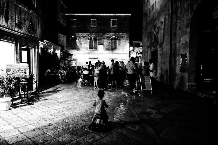 Tourists and locals gather in the local plaza, Croatia