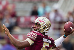 Florida State quarterback Jameis Winston warms up prior to an NCAA college football game against Boston College in Tallahassee, Fla., Saturday, Nov. 22, 2014.  Florida State defeated Boston College 20-17.(AP Photo/Mark Wallheiser)