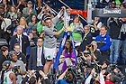 Mar 31, 2014; Kayla McBride (21) holds up the net after Notre Dame defeated the Baylor Bears in the regional final of the 2014 NCAA Tournament. Notre Dame won 88-69. <br /> <br /> Photo by Matt Cashore
