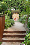 Stone steps lead to the upper patio area of this multi-level Seattle yard.