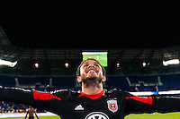 Nick DeLeon (18) of D. C. United celebrates at the end of the match. D. C. United defeated the New York Red Bulls 1-0 (2-1 in aggregate) during the second leg of the MLS Eastern Conference Semifinals at Red Bull Arena in Harrison, NJ, on November 8, 2012.