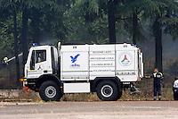 Roma 28 Giugno 2013<br /> Incendio di sterpaglie in via Casilina al civico 900, ex campo rom. Un mezzo  della squadra antincendio della Protezione Civile durante le operazioni di spegnimento dell' incendio.