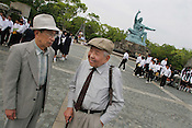 Akira Iwanaga (on left) and Tsutomu Yamaguchi (on right), pay their respects at the Peace Park marking the Nagasaki Atomic bombing blast on 9th August 1945. Photographed in Nagasaki, Japan, Tuesday May 24th 2005. Both men were in Hiroshima on the day of the first atomic bombing, 6th Aug. 1945, and also in Nagasaki three days later on the day of the second atomic bombing of Japan by US Military.