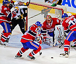 20 December 2008: Montreal Canadiens' goaltender Jaroslav Halak from the Slovak Republic, keeps his eye on the puck after making a save against the Buffalo Sabres during the third period at the Bell Centre in Montreal, Quebec, Canada. With both teams coming off wins, the Canadiens extended their winning streak by defeating the Sabres 4-3 in overtime. ***** Editorial Sales Only ***** Mandatory Photo Credit: Ed Wolfstein Photo