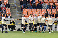 Houston, TX - Friday December 9, 2016: Jon Bakero (7) of the Wake Forest Demon Deacons celebrates his goal in the first half with his teammates against the Denver Pioneers at the  NCAA Men's Soccer Semifinals at BBVA Compass Stadium.