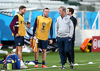 Wayne Rooney of England looks at manager Roy Hodgson during training ahead of tomorrow's Group D match vs Uruguay