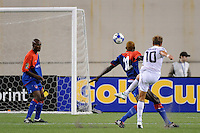 Stuart Holden (10) of the United States (USA) scores the game tying goal in stoppage time. The United States and Haiti played to a 2-2 tie during a CONCACAF Gold Cup Group B group stage match at Gillette Stadium in Foxborough, MA, on July 11, 2009. .
