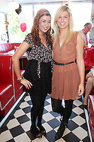 "NO REPRO FEE. 26/5/2011. NEW EDDIE ROCKET'S SHAKE SHOP. Julie Monaghan and Katie Byrne are pictured in the new Eddie Rocket's Shake Shop. The design seeks to recall the vintage milkshake bars from 1950's America and re-imagine them for the 21st century. The new look aims to appeal to both young and old with a quirky and bold colour scheme and a concept of make-your-own milkshakes, based on the tag line ""You make it...We shake it!"". Eddie Rocket's City Diner in the Stillorgan Shopping Centre in south Dublin has re-opened after an exciting re-vamp and the addition of a Shake Shop. Ten new jobs have been created with the Diner's re-launch bringing the total working in Eddie Rocket's Stillorgan to 30. Picture James Horan/Collins Photos"