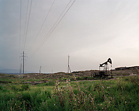 A 'nodding donkey' or pump jack extracting Naftalan oil from the earth, to be pumped to a nearby sanatorium.