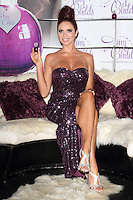 Amy Childs launches her debut fragrance - 'Amy Childs' with a photocall at Aura, St James, London, England..August 15th 2012.full length purple strapless dress sequins sequined sitting legs crossed hair up silver sandals shoes slit split.CAP/ROS.©Steve Ross/Capital Pictures.