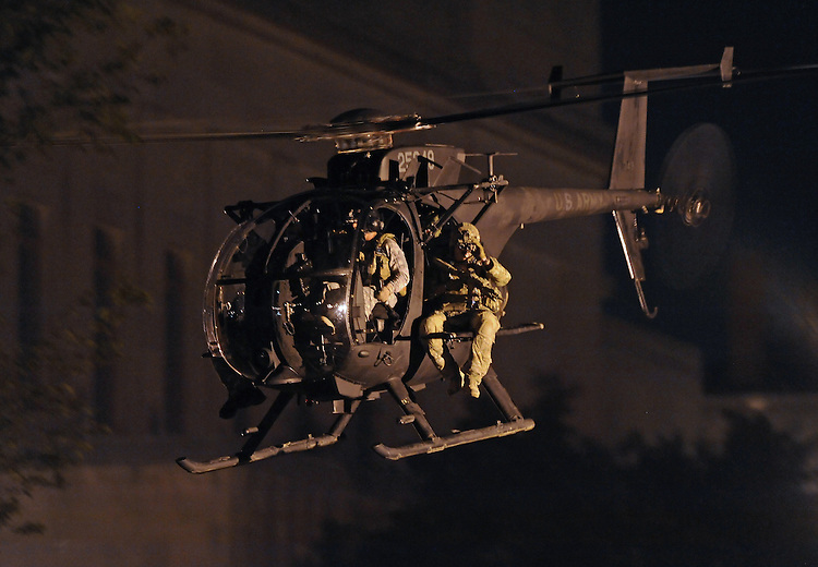 "Night Moves - An MH-6 Little Bird helicopter of the U.S. Army's 160th Special Operations Aviation Regiment, known as the ""Night Stalkers,"" conduct a an urban warfare training exercise involving Special Forces units in Worcester, Mass., on Thursday, August 02, 2012. Photo by Christopher Evans"