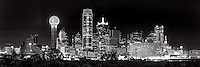 This is an black and white panorama of the Dallas Skyline after dark with only the light from the high rise skyscrapers in view in the downtown area. This cityscape has all the usual iconic dallas buildings like the Reuion Tower, Heritage Plaza, Fountain Place, Bank of America, to the alway colorful Omni Hotel in view.
