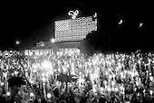 Memphis, Tennessee<br /> USA<br /> August 15, 2002<br /> <br /> A candle vigil of some 50, 000 fans from around the world gather outside of Graceland to mark the 25th anniversary of Elvis Presley's death.