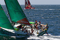 FRANCE, Belle Ile. 1st July 2012. Volvo Ocean Race, Leg 9 Lorient-Galway. Groupama Sailing Team with CAMPER with Emirates Team New Zealand in the distance.