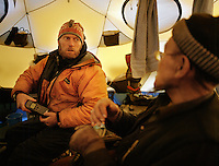 Anthropologist Ted Callahan lets the Khan uses his satellite phone to call Kabul and organize a blanket and food delivery on the Tajik border..Qyzyl Qorum camp. .Winter expedition through the Wakhan Corridor and into the Afghan Pamir mountains, to document the life of the Afghan Kyrgyz tribe. January/February 2008. Afghanistan