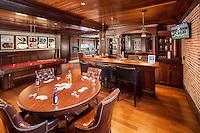 Basement Bar/Billiard Room with Hidden Speakers and Multiple Displays