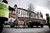 Krakow 18/04/2010 Poland<br /> People mourning the tragic death of President Lech Kaczynski and his wife in Krakow before funeral.<br /> on pictures: The flag-draped coffins were pulled by Humvees, as soldiers in berets slowly marched beside. Coffin with polish President Lech Kaczynski at Wawel.<br /> Photo: Adam Lach / Napo Images for The New York Times<br /> <br /> Zaloba po tragicznej smierci Prezydenta Lecha Kaczynskiego i jego malzonki w Krakowie przed pogrzebem.<br /> na zdjeciu: trumna z cialem Lecha Kaczynskiego przed Wawelem.<br /> Fot: Adam Lach / Napo Images for The New York Times