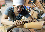 "Misawa Shunichi stripping lengths of bamboo in a process known as  ""kawa-migaki"" (literally ""skin polishing"") at Iwao Chikuran's workshop in Beppu City, Oita Prefecture, Japan on Sept. 20. 2016.  ROB GILHOOLY PHOTO"