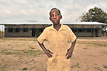 Enosa Likambo, 10, stands in front of his school in Nyei, a village in SOuthern Sudan where people have returned after years in exile to rebuild their land after a devastating civil war. The school was constructed by the United Methodist Committee on Relief (UMCOR). NOTE: In July 2011, Southern Sudan became the independent country of South Sudan
