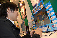 A visitor to the game show plays a game where the characters are hair follicles. On the stall of a programming school.