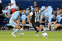 Newcastle United midfielder Hatem Ben Afra moving away from Jeferson Sporting KC... Sporting Kansas City and Newcastle United played to a 0-0 tie in an international friendly at LIVESTRONG Sporting Park, Kansas City, Kansas.