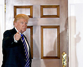 United States President-elect Donald Trump returns to the clubhouse of Trump International Golf Club, November 19, 2016 in Bedminster Township, New Jersey. <br /> Credit: Aude Guerrucci / Pool via CNP