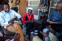 "A group of men play casino at ""Skomplaas"" hostel, one of Durban Deep Goldmine's old hostels on the outskirts of Johannesburg, South Africa."