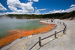 Tourists visit he brilliantly coloured Champagne Pool at the geothermal site, Wai-O-Tapu Thermal Wonderland, near Rotorua on the North Island of New Zealand.