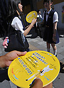 July 11th, 2011, Tokyo, Japan - Japanese government campaign staff distributes leaflets in Tokyo on Monday, July 11, 2011, notifying Tokyoites the approaching deadline of analogue TV broadcast. The analogue broadcasts will be discontinued on July 24, less than two weeks before it will be completely taken over by digital broadcasting. Terrestrial digital TV broadcasting enables Japanese TV viewers to receive higher quality video and audio signals than conventional analog TV with no ghost images and no noise. (Photo by Natsuki Sakai/AFLO) [3615] -mis-.