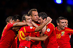 Macedonia's Nikolche Noveski is mobbed after scoring the opener