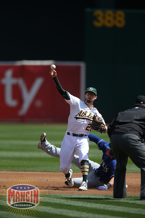 OAKLAND, CA - APRIL 9:  Eric Sogard #28 of the Oakland Athletics makes a play at second base against the Texas Rangers during the game at O.co Coliseum on Thursday, April 9, 2015 in Oakland, California. Photo by Brad Mangin