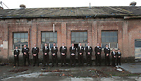 A groom and his groomsmen pose for a portrait at the Old Sugar Mill in Clarksburg, California a great place for wedding photos.