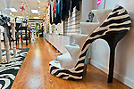 Nov. 23, 2012 - Merrick, New York, U.S. - All Dazzle, a women's fashion and accessory boutique on Long Island, has sales and is decorated in red, white, and black for the winter holidays. One of the display stands looks like a giant stiletto high heel in a zebra print.