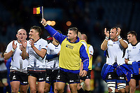 Paulica Ion of Romania waves a Romanian flag in celebration after the match. Rugby World Cup Pool D match between Canada and Romania on October 6, 2015 at Leicester City Stadium in Leicester, England. Photo by: Patrick Khachfe / Onside Images