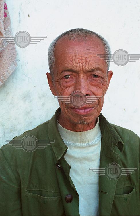 Portrait of a man in a village near Yongle.