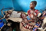 A woman visits her spouse in the United Methodist Hospital in the village of Wembo Nyama, DR Congo.